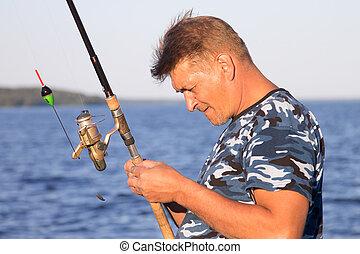 Fisherman on the lake closeup