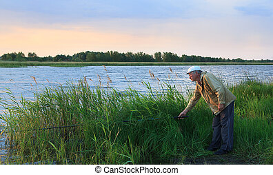 Fisherman on the lake in the early morning.