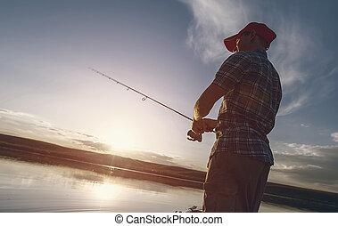 Fisherman on the pond