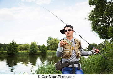 Fisherman on the river bank