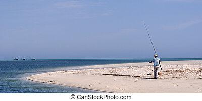 fisherman on the sea shore