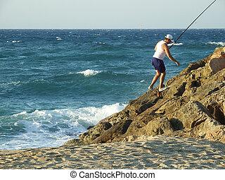 fisherman on the shore