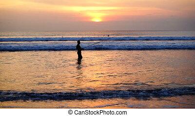Fisherman posing in sunset.