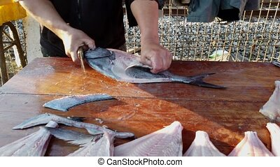 Fisherman Prepares Reine Fish From Full Fish to Skinned Carcass.