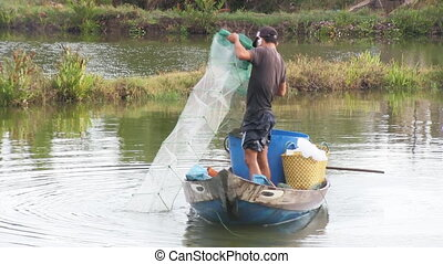 Fisherman pulling in his net