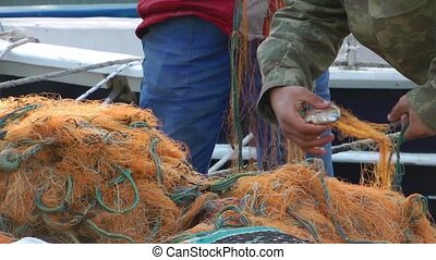 Fisherman Repairs Fishnet Fishing Lines
