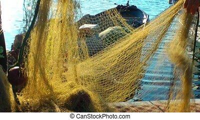 Fisherman Repairs Fishnet Fishing Lines