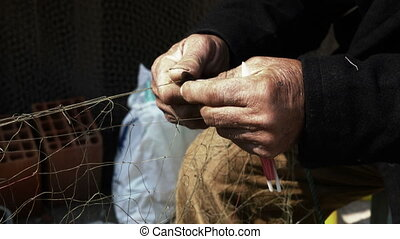 Fisherman Repairs Fishnets Fishing Lines