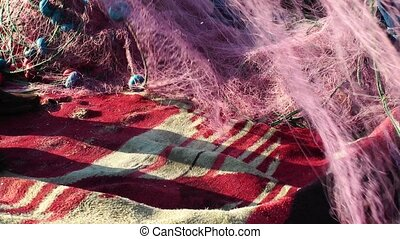 Fisherman Repairs fishnets