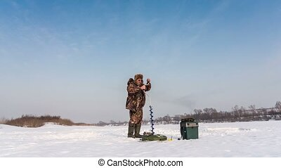 Fisherman sets a tent for winter fishing