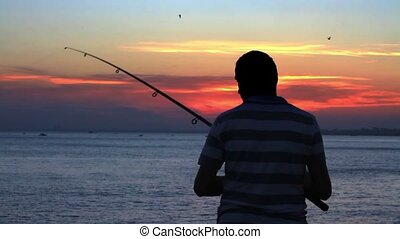 Fisherman - Silhouette of the fisherman by sunset