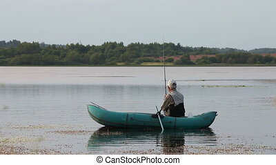 Fisherman - The fisherman in a boat on the river