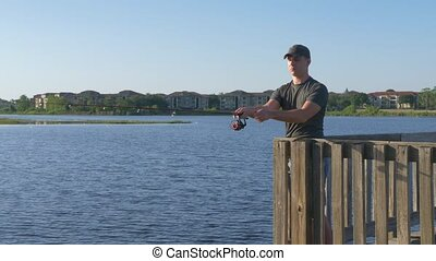 Man fisherman catches a fish. - Fisherman throws a fishing...
