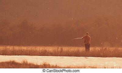 fisherman throws the bait slow motion video - fisherman...