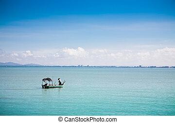 Fisherman under the work - Fishing boat in Penang bay....