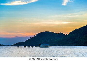 fisherman village on the lake in sunset