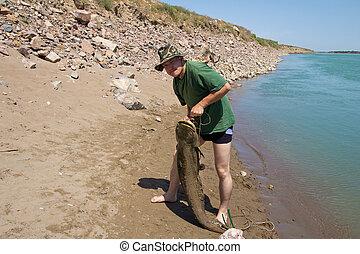 fisherman with a big catfish