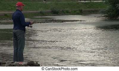 Fisherman with a fishing rod