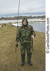 fisherman with a pike