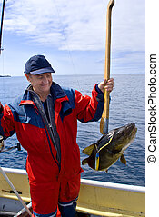 Fisherman with big fish - Fisherman with fish on the boat...