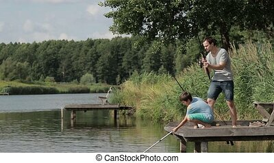 Fisherman with fishing rod fighting the fish