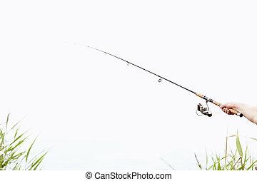 Fisherman with rod closeup