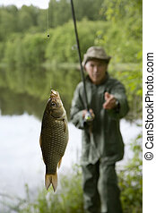 Fisherman with trophy carp