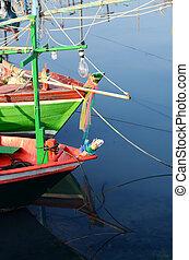 Fisherman's boat ashor at fishing pier in Hua Hin.