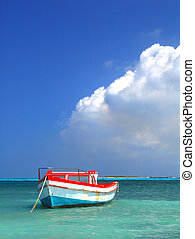 Fisherman's boat in a tranquil bay outside of Oranjestad Aruba of the Netherlands