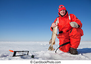 Fishermans catch - Happy ice fisherman holding a northern...