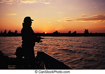 fisherman\'s dreams - fisherman casting at sunset in hopes...
