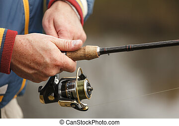 Fisherman`s hands with spinning. - Closeup of Fisherman`s ...