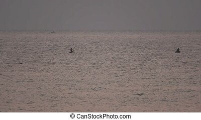Traditional Fishermans over wooden boat in Lake Malawi at sunrise with text space