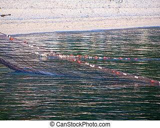 Fisherman's net in the sea