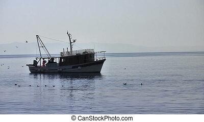 Fishermans on fishing boat