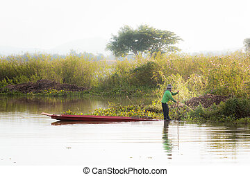 Fishermen are rowing