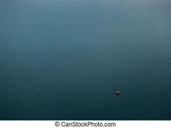 Fishermen at boat on the blue big lake