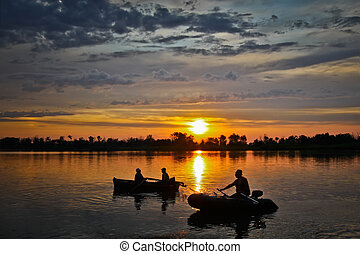 Fishermen at sunset return