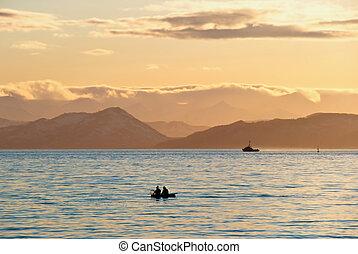 Fishermen boat in sunset