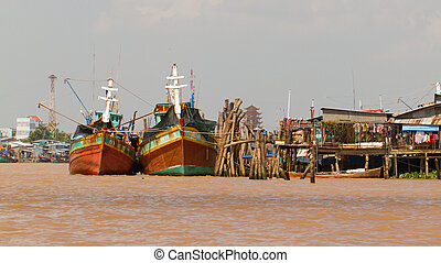 Fishermen boats in a river in the Mekong Delta