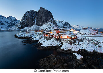 Fishermen cabins (rorbu) in the Hamnoy village at twilight in winter season, Lofoten islands, Norway