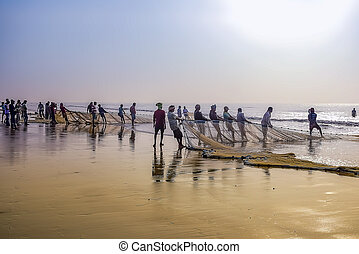 Fishermen cathing fish in early morning time after whole night fight coming shore back to home from the oumb of ocean everyday life style and fight of life for the livings.Digha India. Asia.