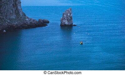 Fishermen in a small boat in the sea.