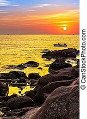 fishermen in the boat at sunrise