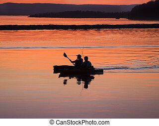 Fishermen kayaking