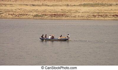 Fishermen laying nets on Ganga River, India - Medium...