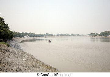 Fishermen on a boat in Sundarbans,