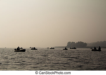 Fishermen on a boat in the fog