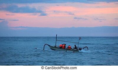 Fishermen on a boat in the ocean