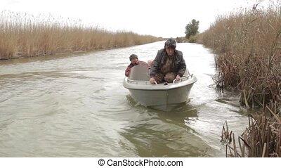 Fishermen on fishing - Fishermen catch fish with a motor...